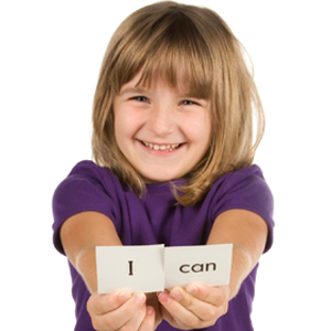 "Little girl holding ""I can"" sign"